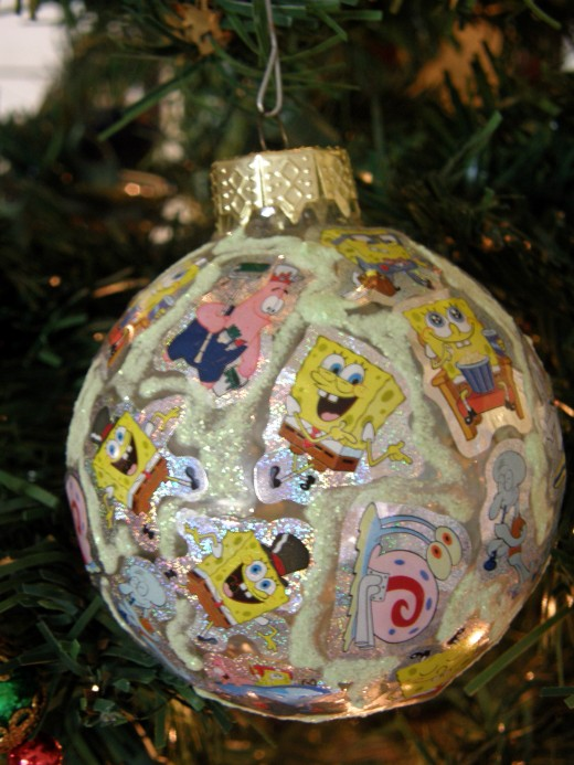 My youngest son made this ornament when he was in Kindergarten.  It is simply made from stickers, and we love it.