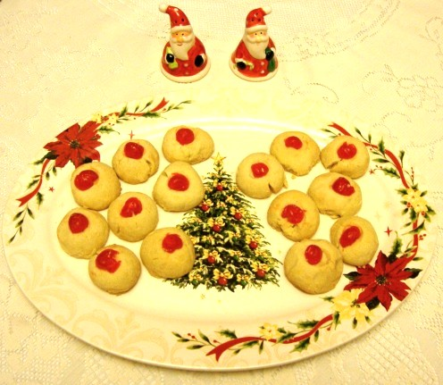 Sink-your-teeth-into melting cherry shortbread cookies on a yuletide platter.