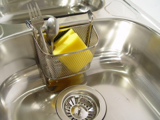 Never use chemical cleaners if you have a garbage disposer, as this can cause damage to the unit.  If you are trying to remove a clog from the disposer, make sure that you switch it off first and never stick your hands inside as the blades are sharp.