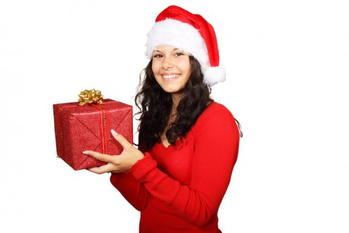 Perfect way to open a Christmas gift: Smiling although you know a cheap cousin gave the gift to you