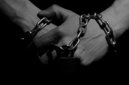 A man in chains.