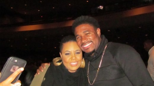 Carol Riddick, takes a quick photo with her son. Carol, is one of the most talented women in the music industry at this present time.