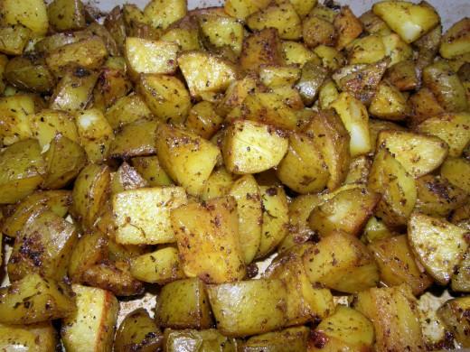 Baked spiced  turmeric potatoes