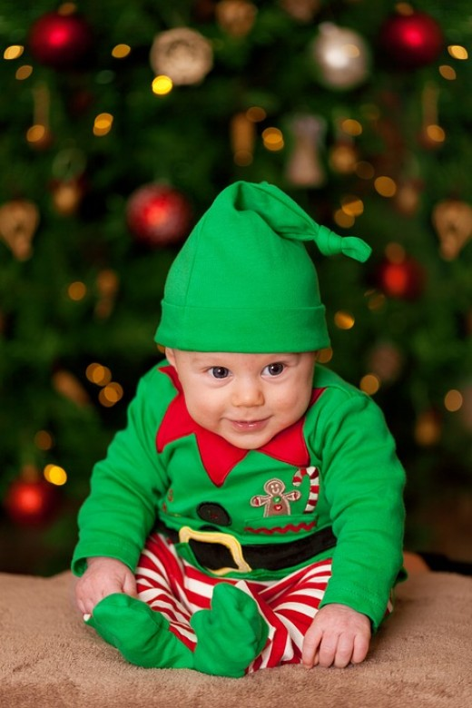 Here's an adorable elf costume for a baby...see the collar and the striped tights? They make the costume.
