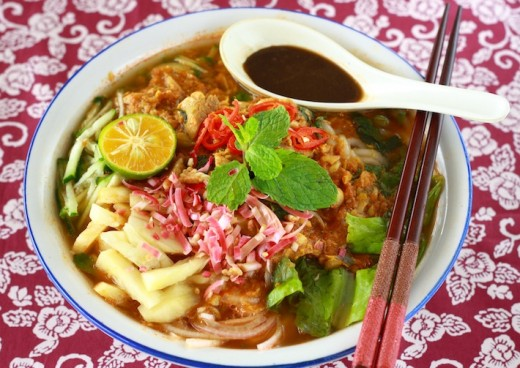 Laksa is a popular spicy noodle soup in the Peranakan cuisine, which is a combination of Chinese and Malay cuisine.