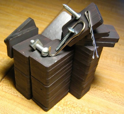 Example 4.(Magnets) Some common magnets attracting irons.