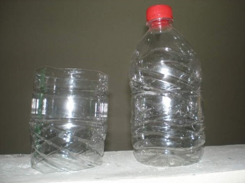 After you cut the middle part of the plastic bottle, it'll be this high.