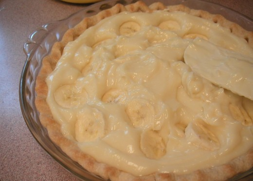 If you forget to layer the baked crust with sliced bananas, add them afterward.