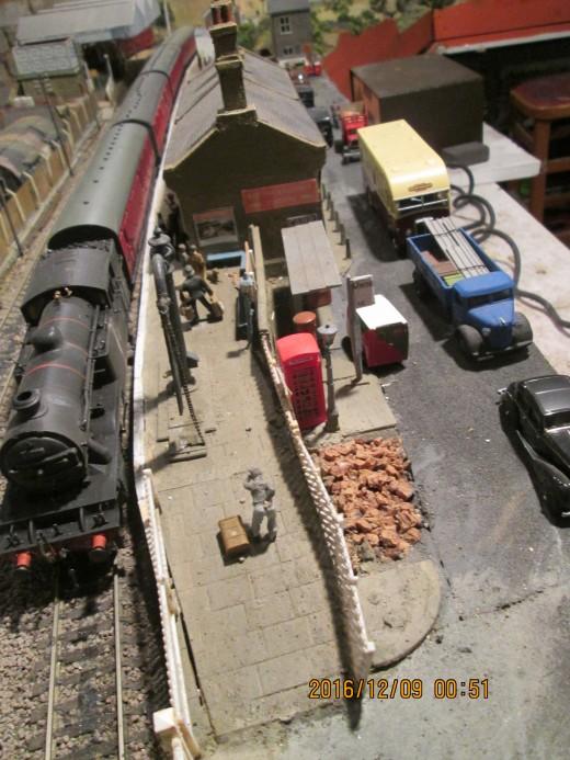 Class V3 2-6-2 tank locomotive brings non-corridor passenger stock to a halt at Thoraldby's platform