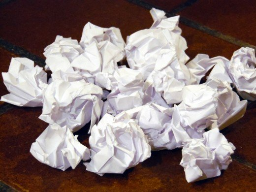 I prefer small crumpled balls of paper, but one large crumpled ball works fine.