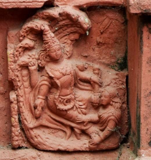 Lord Narayana with Goddess Lakshmi : Left base panel : Nandadulal Jiu ntemple, Gurap