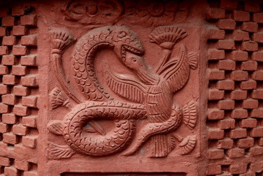 A snake devouring a bird : Decorations on pillar : Nandadulal Jiu temple, Gurap