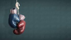 Professional boxers gloves range from 8 ounces up to 12 ounces depending on the weight class.