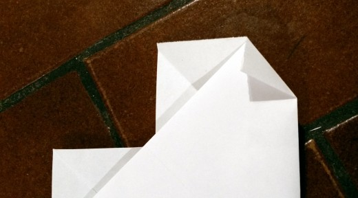 Simply fold in the two side corners poking out. This will help you round out your paper heart.