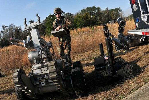 A soldier using a military robot.