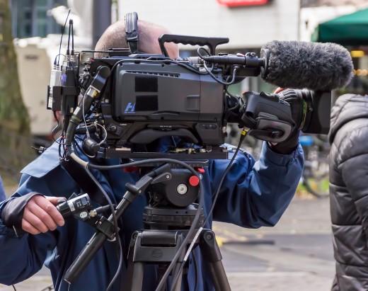 Film cameraman recording on location.