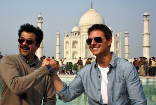 Anil Kapoor, star of hundreds of Indian movies with Tom Cruise.  Who owns the copyright if many people were at the Taj Mahal taking pictures?
