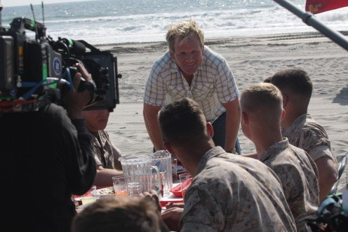 Gordon Ramsay, co-host of the reality TV show, Master Chef, asks Marines their opinion on the food prepared by contestants during a taping of an episode at Camp Pendleton.