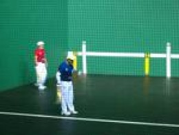 Two Jai-alai players, or pelotaris.