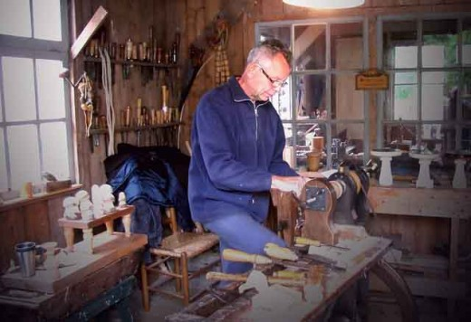 A woodworking craftsman busy at work creating his masterpieces.