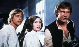 Princess Leia flanked by Luke Skywalker and Hans Solo