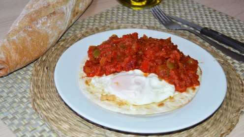 This version of ranch style eggs has the eggs with the tortilla however, it also has lots of salsa!
