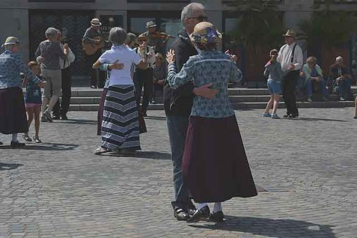 Couples dancing at their local block party.