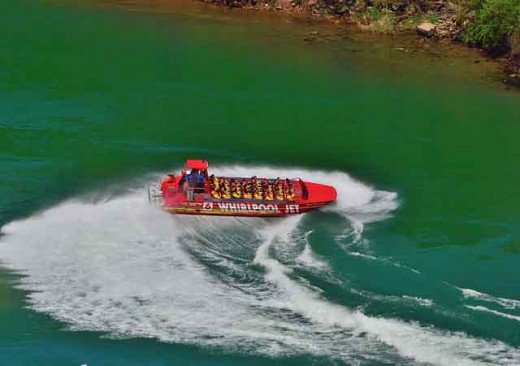 The captain of a jet boat doing a reverse turn.