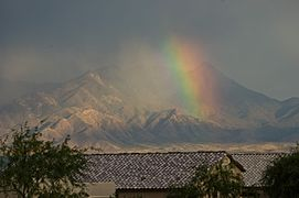 The colors change by time of day, but in the early afternoon the Santa Ritas are a mix of earth tone colors.