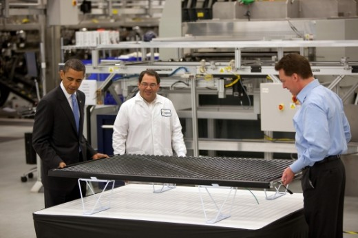 President Obama examines a solar panel at the California Solyndra plant - now closed