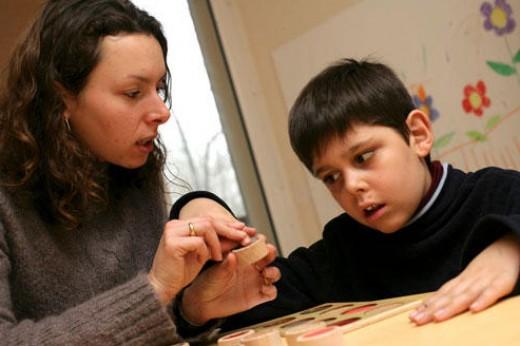An autism patient receiving some help