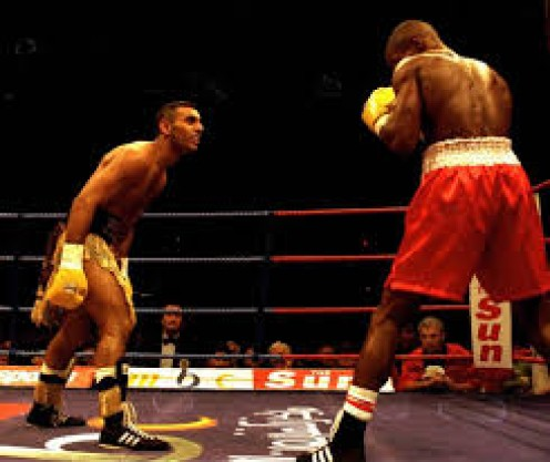 Steve Robinson lost by 8th round TKO against Prince Naseem Hamed in a WBO featherweight world title fight.