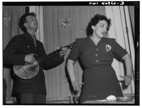 Pete Seeger, left, singing