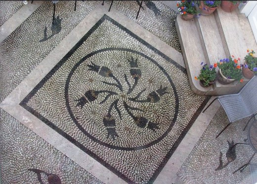 Pebble mosaic with tulip motif in courtyard of the Erten Konak Hotel is in the Sultanahmet district of Istanbul