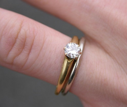 White gold wedding band and single diamond yellow gold engagement ring.