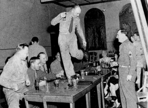 Drunken soldier dances on table in a local club during World War II.