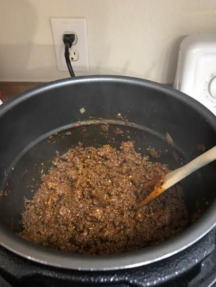 Brown ground beef and onions
