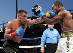 Vasyl Lomachenko won the WBO featherweight title by easily beating Gary Russell by decision.