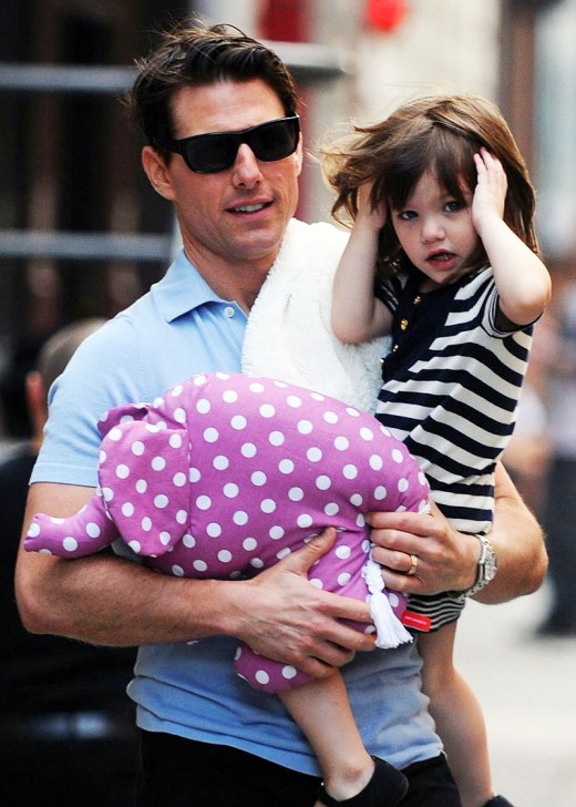 Suri Cruise with her dad Tom Cruise. Katie Holmes is her mom.