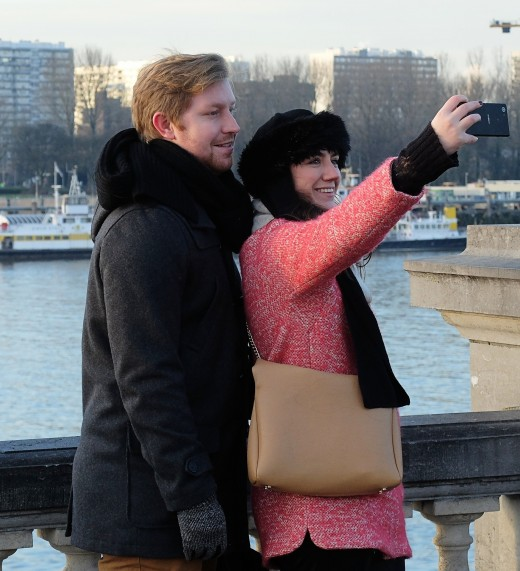 The only reason you should have your mobile phone out on a Valentine's Day date with your spouse is to take a romantic selfie of the two of you.