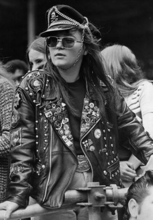 I love all the chains and pins this biker chick has on her hat and jacket.