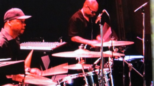 "Kenneth (DJ ""E"") Calloway, is a drummer for Traxx9 Band. He also serves as a Music Producer and Engineer."