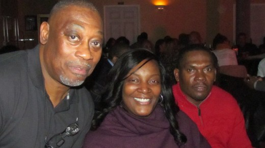 Ted Robinson, who is bassist for the band Traxx9, poses with family members who also came to enjoy the performance.