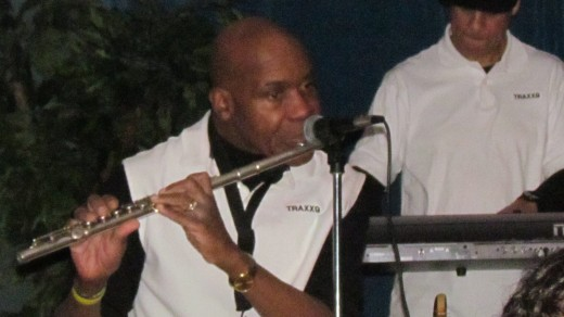 Jerry Blake, performs on his flute as well during his band's performance.