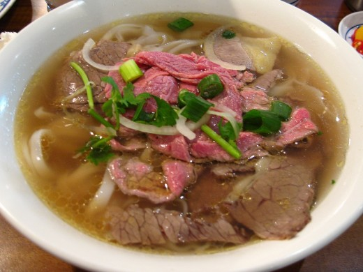 Learn how to prepare delicious homemade Beef Pho soup with this delightful easy to prepare recipe featuring fresh herbs and vegetables.