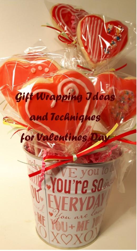A Valentine motif mini-bucket holds handmade Valentine cookie bouquet