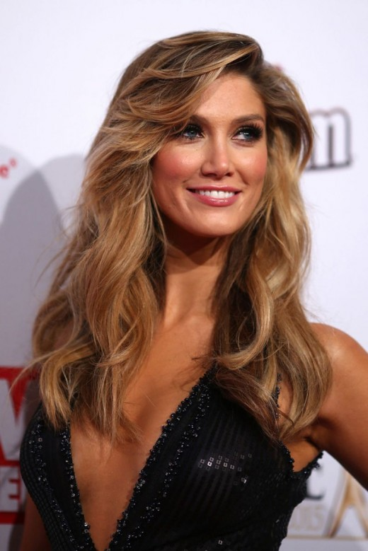 Delta Goodrem (32 years old) or