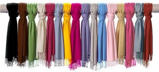 Tied scarves are pretty! Draping them over a peg might be easier.