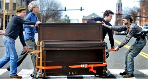 Piano Being Moved On A Piano Dolley