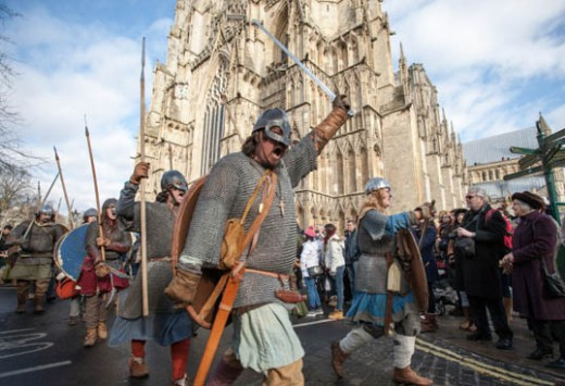 On the Saturday, around midday in 2014 re-enactors begin a march-past through the streets from the cathedral, by way of Coppergate to the castle green...